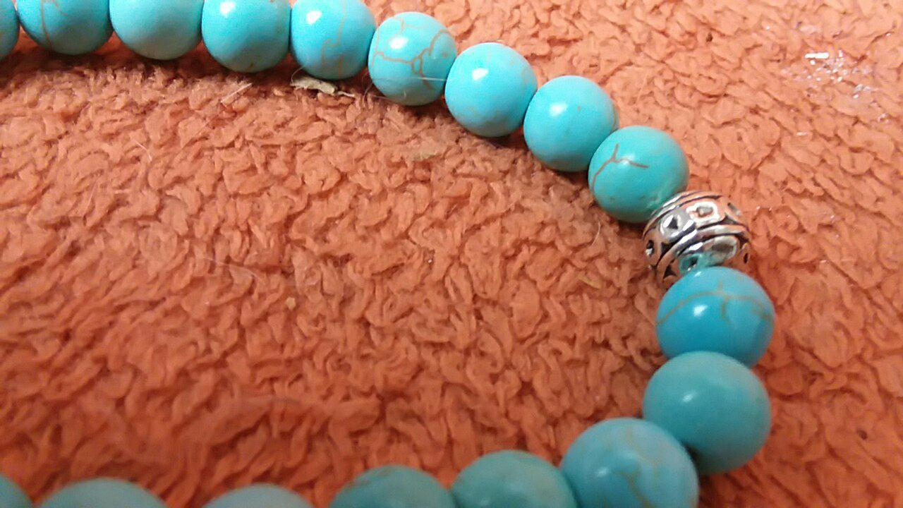 Perfect gift for anyone who likes turquoise, high quality, shiny charms, very pretty, can be used with essential oils, too!