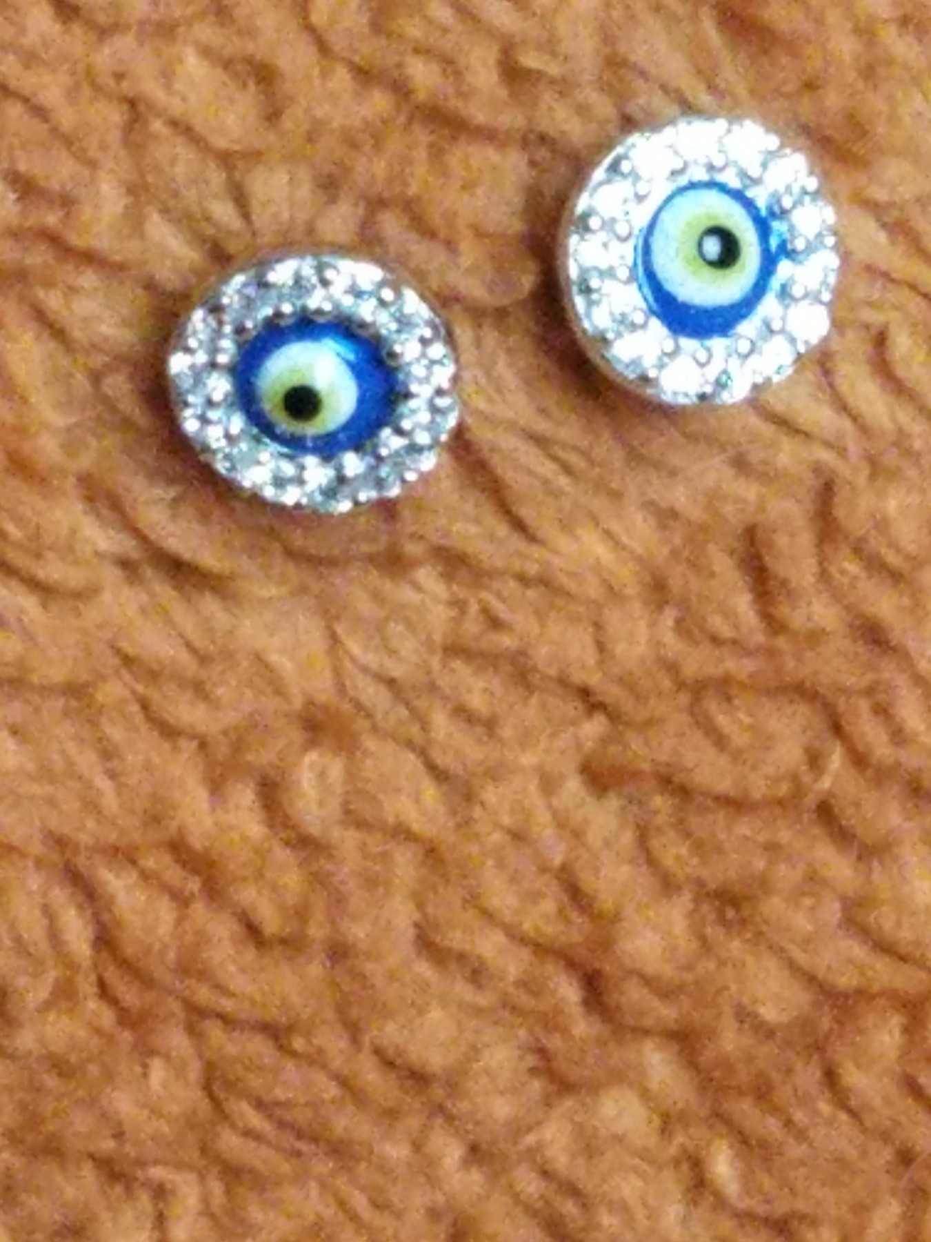 Gorgeous classic Evil Eye symbolism surrounded by cubic zirconias that sparkle and plated with Rhodium over real Sterling Silver, very pretty!