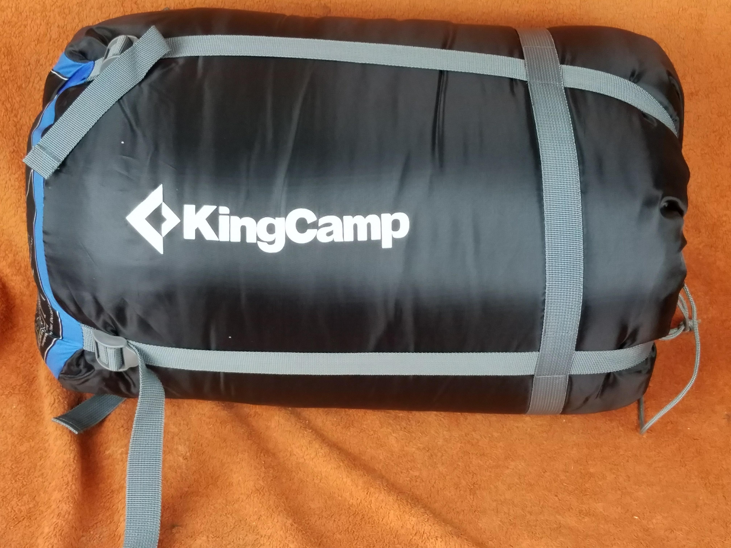 Cozy, super warm blue queen sized sleeping bag can fit 2 people or be seperated to make 2 regular sleeping bags, comes with pillows & compression bag.