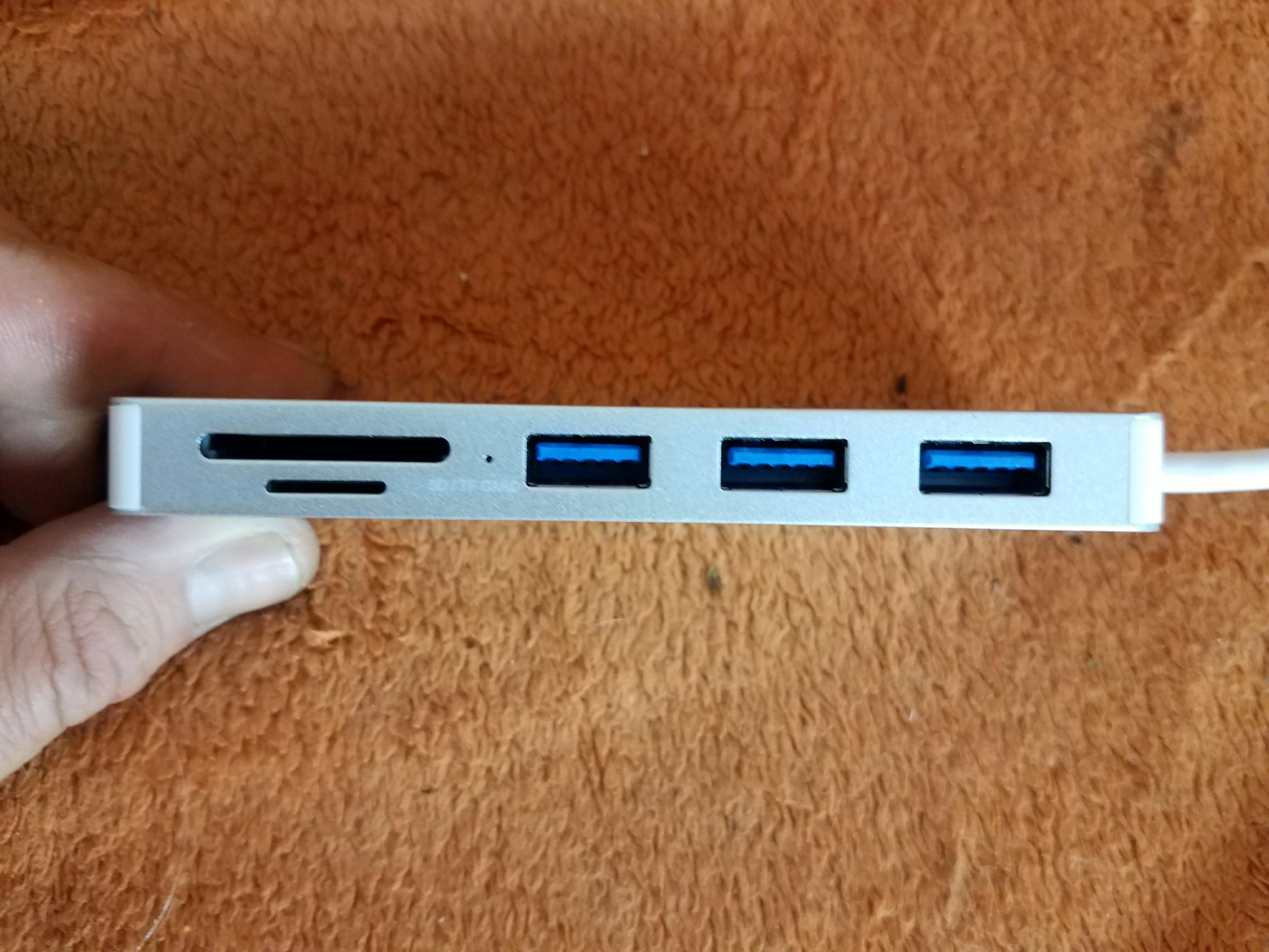 A simple, silver solution to not having enough USB ports available at once, magically turns 1 port into 3 ports!  Includes SD Card Reader, no downloads required, plug & play!