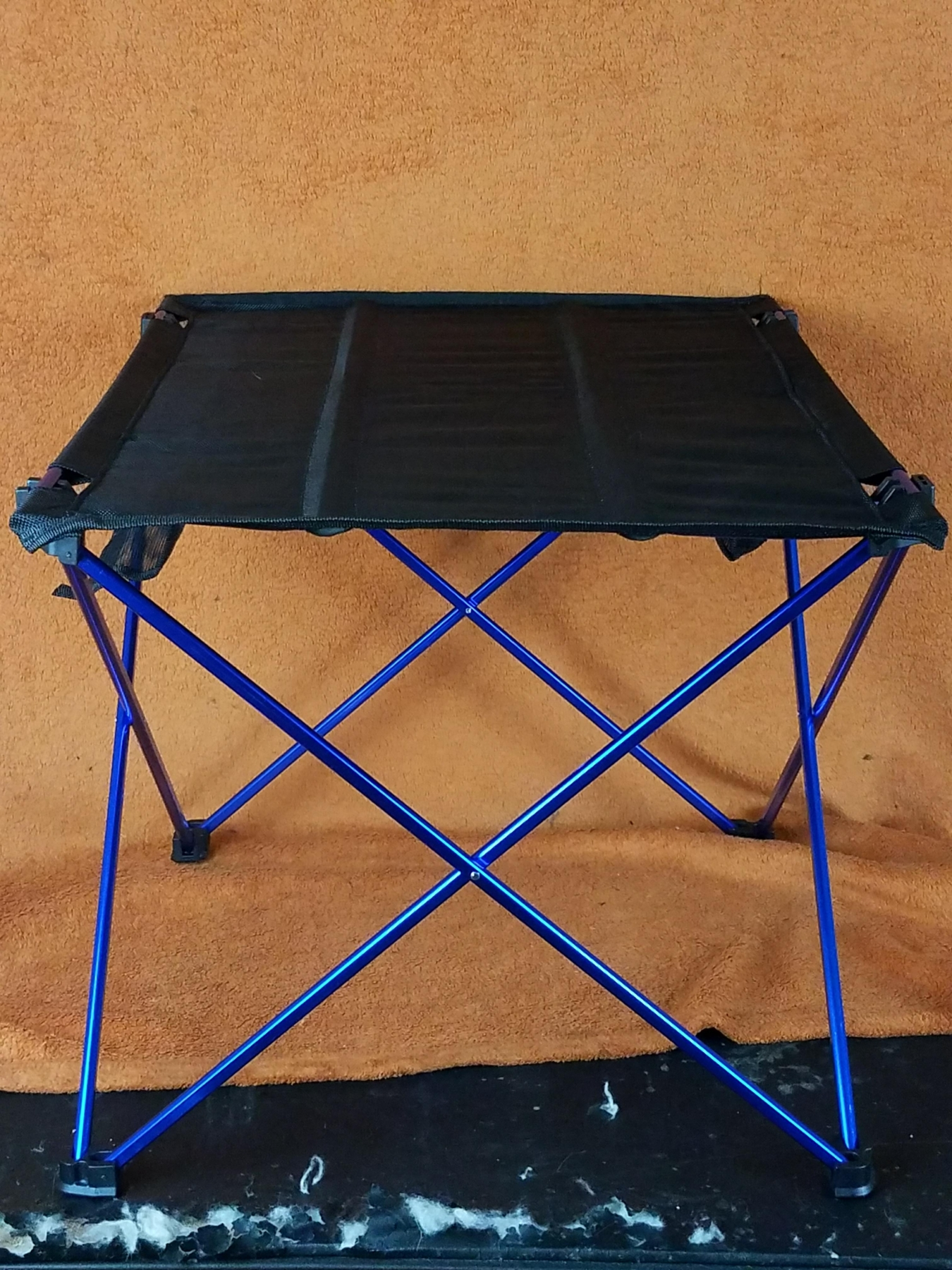 Very lightweight & portable table, comes with it's own storage bag, takes less than one minute to set up, easily folds up when done, high quality!
