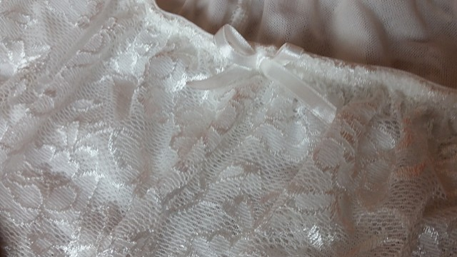 Lovely in lace!  Gorgeous floral lace print, bright white in color, very unique, sexy, flirty, & feminine, comfy, cute & sure to please!