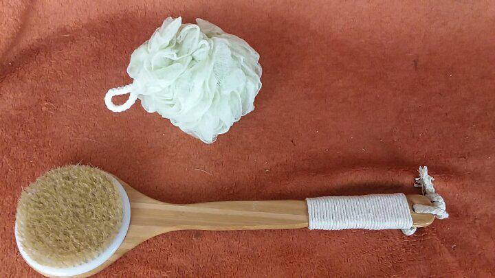 All natural, Eco-friendly body brush with green shower poof/sponge set, has nice handle, wood is soft & smooth, gentle bristles clean well.
