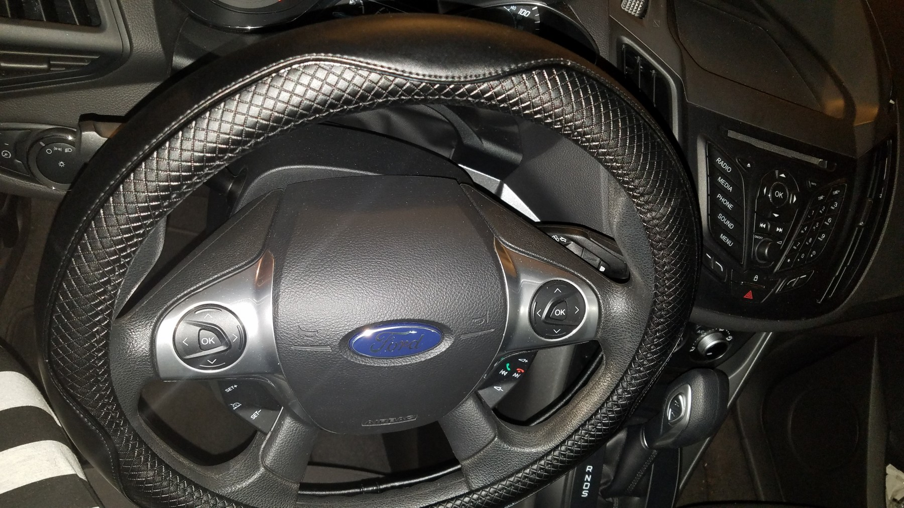 New steering wheel cover for our Ford Escape