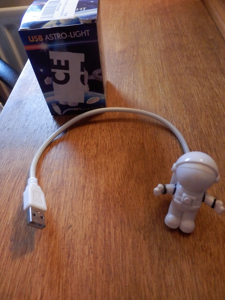 An original USB LED light in the shape of an astronaut, gives enough light to work in the dark