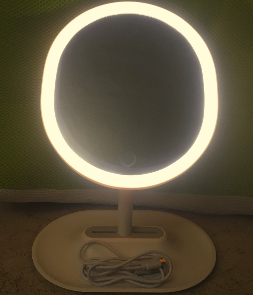 A beautiful, lighted, oval-shaped, rechargeable LED makeup mirror.