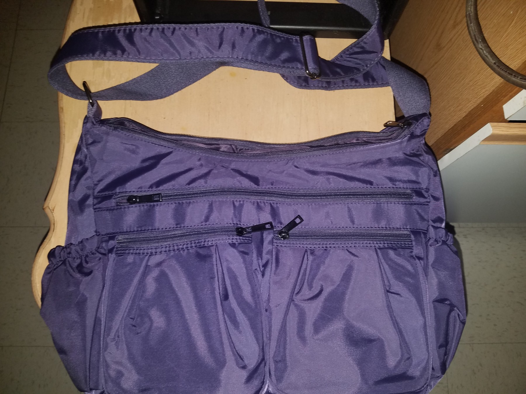 Great quality, roomy purse w/ adjustable strap!