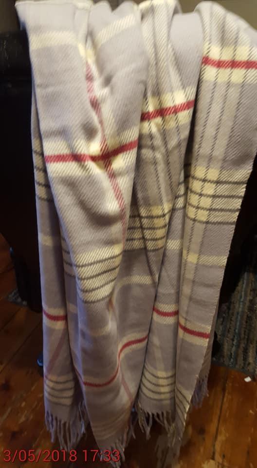 A Nice Blanket, but concerning loose strands near base of tassel