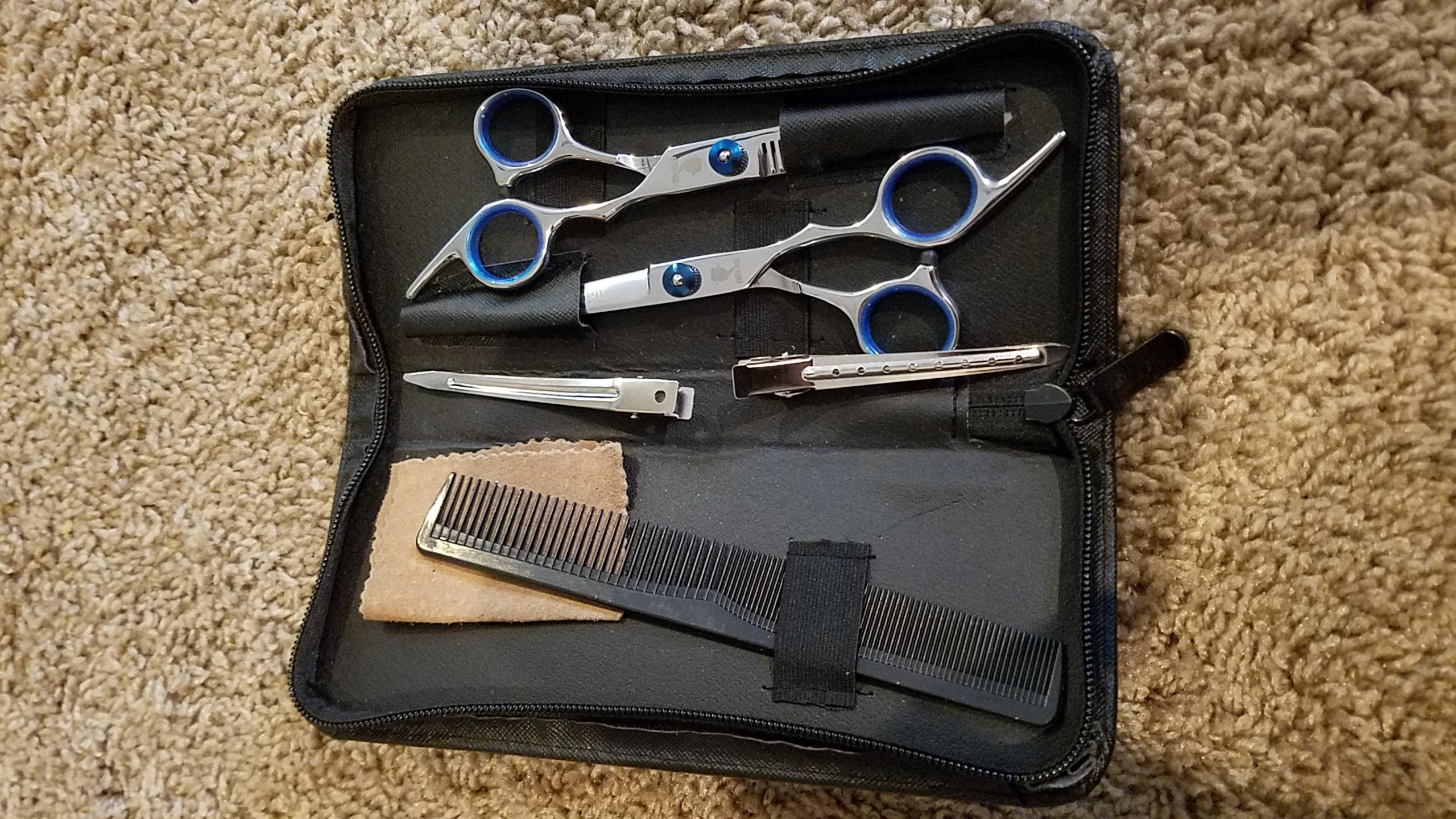 The case is sloppy and cheap, but the scissors have a high quality feel!