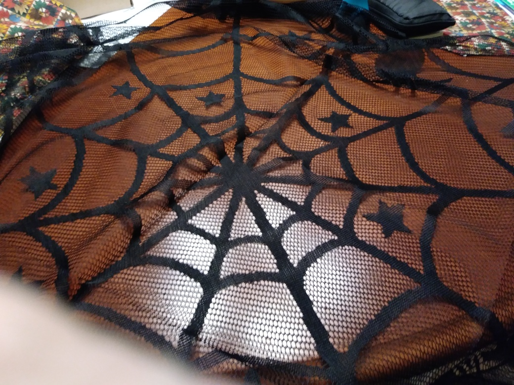 Lovely Lace spider web table cloth Perfect for Halloween!