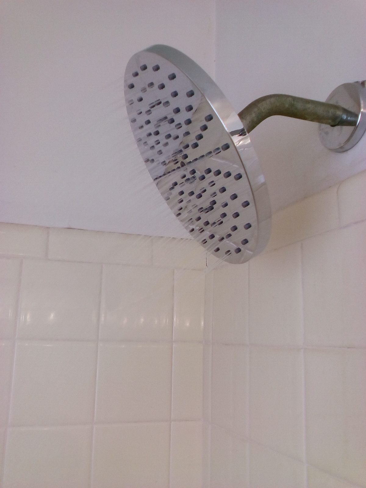 Water-saving rain shower head, works wonderfully