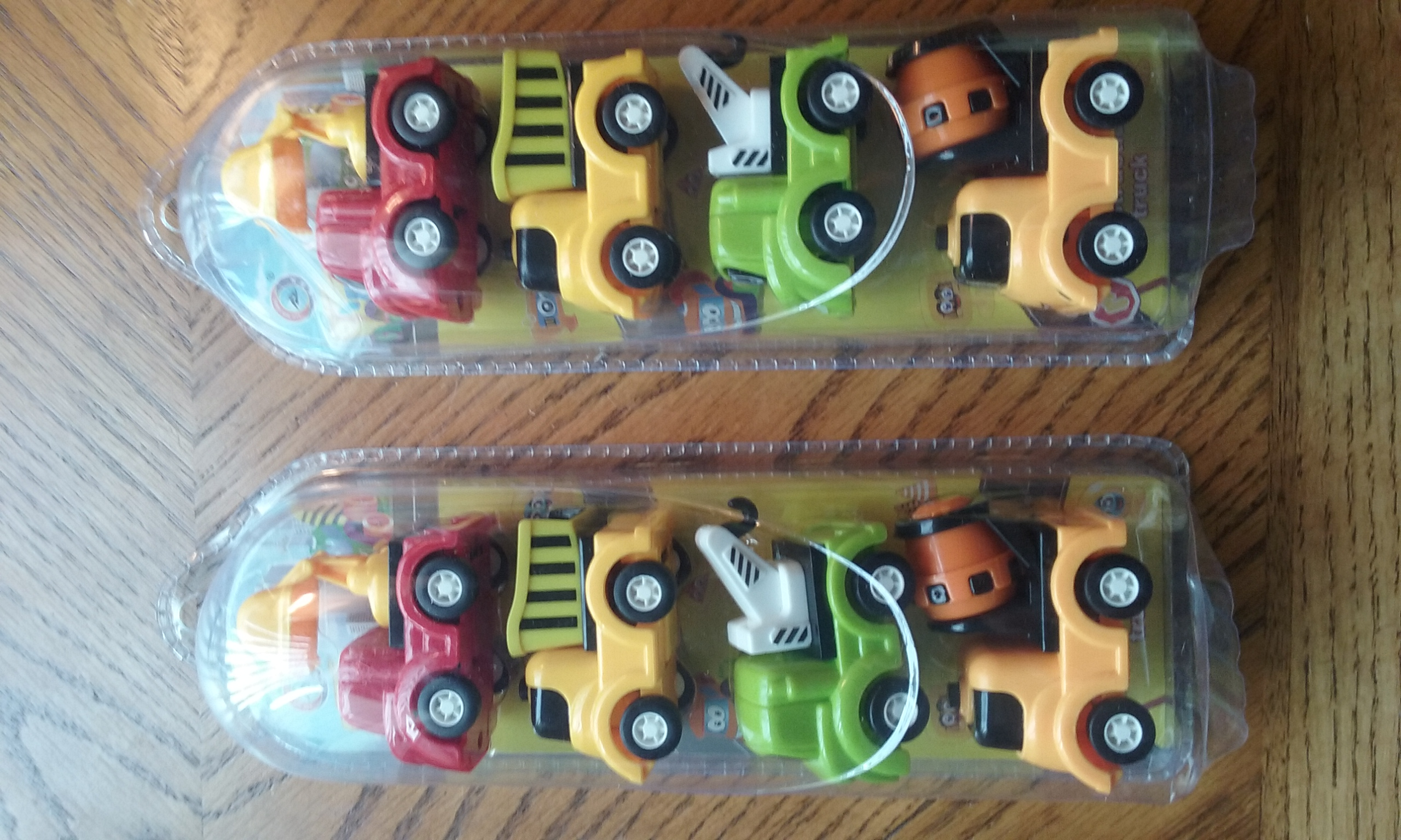 SMALL TOY CONSTRUCTION SET OF 4 TRUCKS